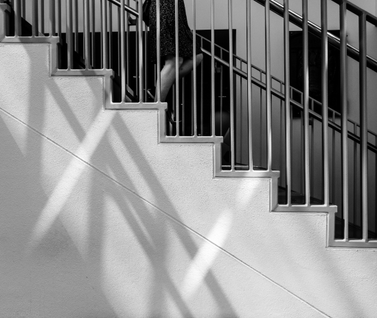 a woman ascends the stairs